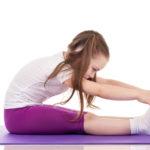 Little girl doing fitness exercises